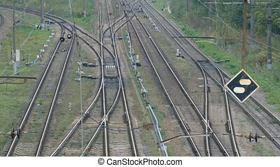 Empty railroad track with some train switches and electrical...