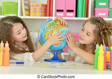 Cute girls on lesson - portrait of Cute girls on lesson with...