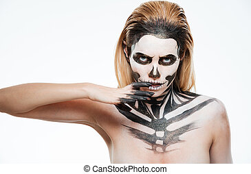 Portrait of young woman with gothic skeleton makeup over...