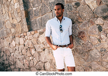 Casually handsome. Handsome young African man in smart...