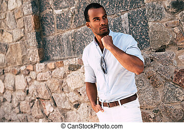 Cool and stylish. Handsome young African man in smart casual...