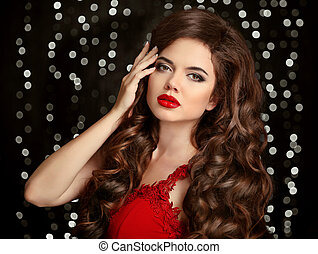Brunette girl with long shiny wavy hair Red lips Beauty...