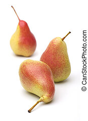 Three ripe yellow-red pears on a white background