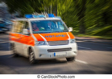 german emergency ambulance car drives on the street