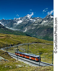 Gornergrat train in Switzerland Alps - Gornergratbahn train...
