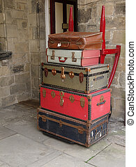 Vintage Luggage - Old suitcases stacked on a trolley...