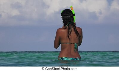 Bikini Clad Woman In Ocean Smiling And Laughing With Snorkel