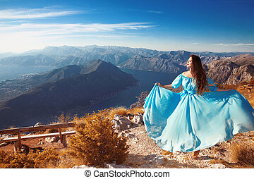 Montenegro landscape above Kotor bay. Beautiful woman in...