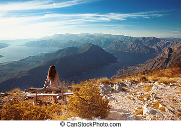 Kotor bay. Montenegro. Romantic Woman on bench above...