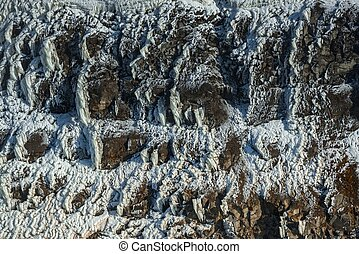 Frozen ice on rocks - Frozen crystallized ice on sharp rocks...