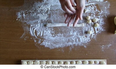 Woman Preparing Gnocchi - Woman hands making gnocchi pasta.