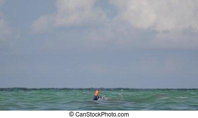 Tourist Man Having Fun Swimming In Ocean Water