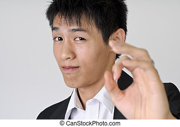 Ok - Young business man give you Ok gesture with copyspace.