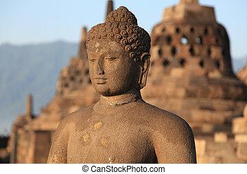 Statue of Buddha in Borobudur temple in Indonesia , Java