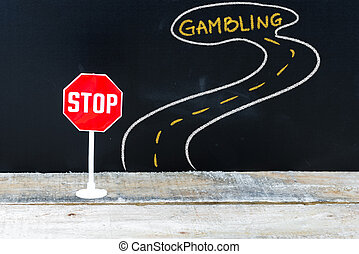 Mini STOP sign on the road to GAMBLING
