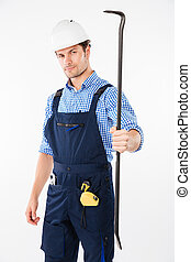 Serious male builder holding crowbar isolated on a white...