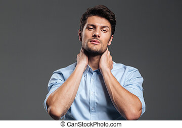 Businessman with eyes closed having neck pain - Portrait of...