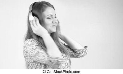 woman with headphones listen to the music