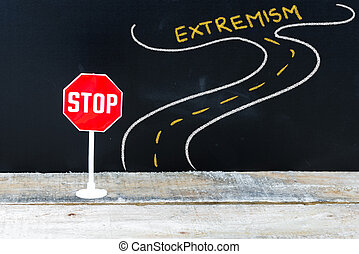 Mini STOP sign on the road to EXTREMISM, hand drawing over...