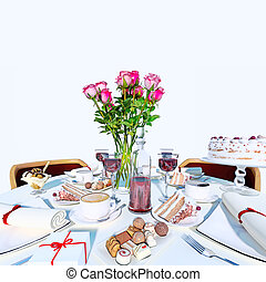 Table setting in white color. - Holiday table setting in...