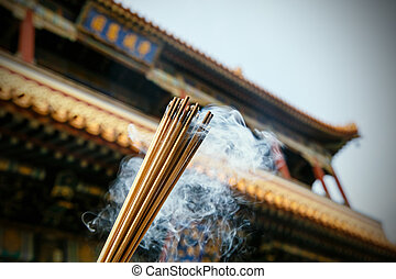 Close up of burning incense sticks in a pagoda, Beijing,...