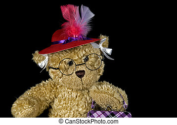 Red Hat - Teddy bear wearing a red hat.