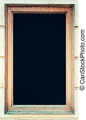 Rustic wooden frame with black chalkboard as copy space