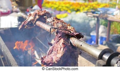Meat roasted on a spit - cooking meat on the fire