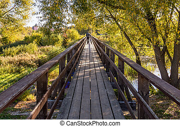 wide angle wooden bridge over river