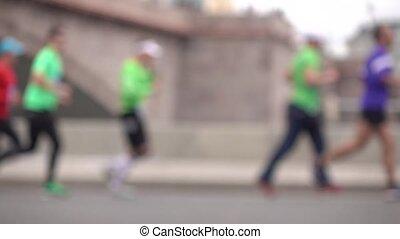 Unrecognizable blurred city marathon runners. Competition concept. Super slow motion shot