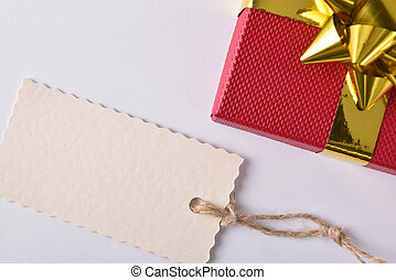 Red gift with golden ribbon and label down