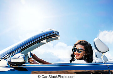 Young black female driver in convertible.