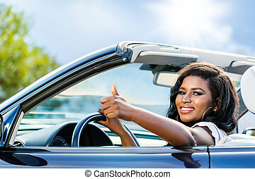 Cute young african driver doing thumbs up. - Close up...
