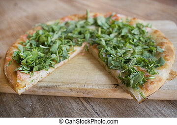 pizza with smoked salmon and arugula - homemade pizza with...