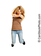 Young student jumping with thumbs up - Young casual student...