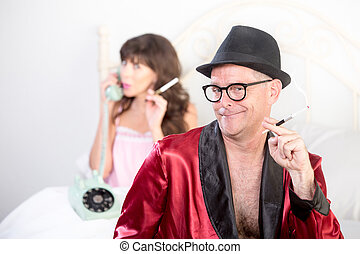 Smoking Playboy with Woman on the Phone in Background -...