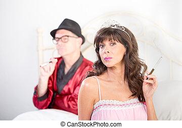 Smoking Princess and Playboy - Portrait of smoking playboy...