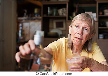 Woman reaching for bottle of liquor - Lonely senior adult...