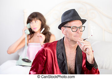 Playboy with Woman on the Phone in Background