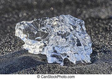 Ice crystal, Iceland - Ice crystal on black lava beach,...