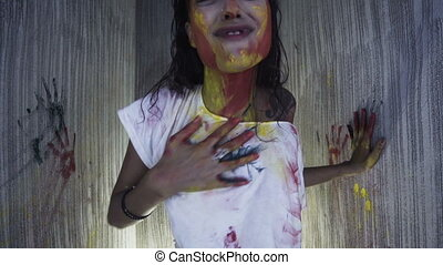 Beautiful woman with paint in small studio room - Beautiful...