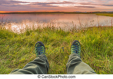 Hiking boots and tundra sunset at Iceland, summer time, 2016