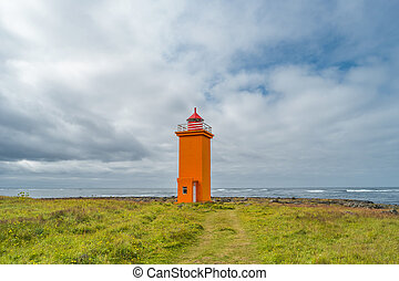 Lighthouse at seashore of Iceland, summer time - Lighthouse...