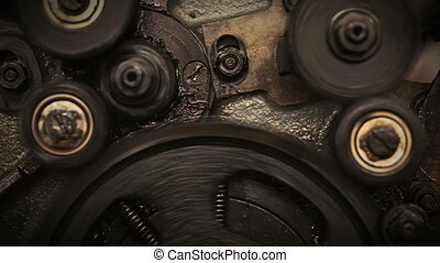 Camera moving through spinning gears and cogs.