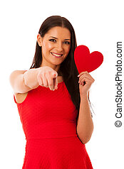 Woman in love wearing red dress holding red heart sending...