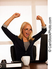Business success - woman celebrating a victory or triumph...