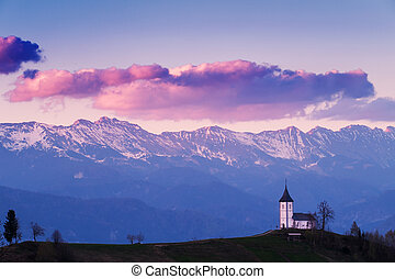 Church on the hill at sunset at Jamnik, Slovenia