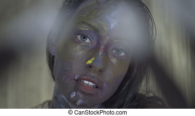 Beautiful woman with paint in small studio room - Closeup of...