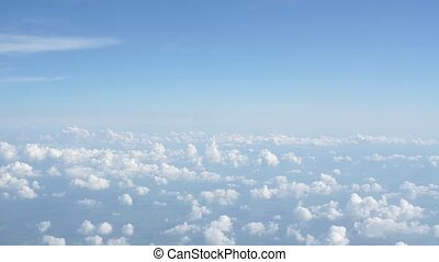 View of beautiful cloud and wing of airplane from window,Sky...