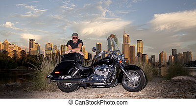 Biker - Bike rider with city of Brisbane Australia in the...